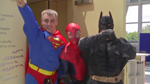 Superhero window cleaners visit children's hospital