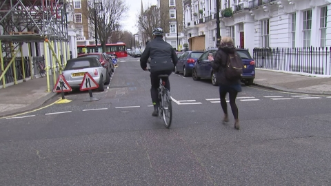 Jeremy Hunt cycles away from reporters as he leaves home