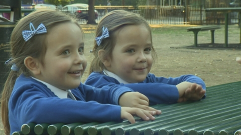 Conjoined twins defy the odds to start first day at school