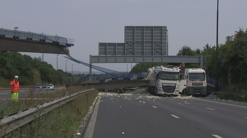 Pedestrian bridge collapses on motorway