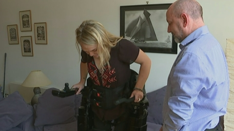 Paralysed woman learns to walk with robotic skeleton